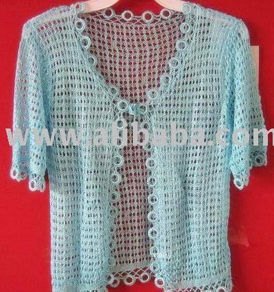 На фото: Модные вязаные ажурные кофты крючком.